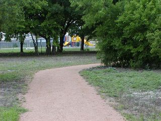 View along the District's hike and bike trail system with playground in background.